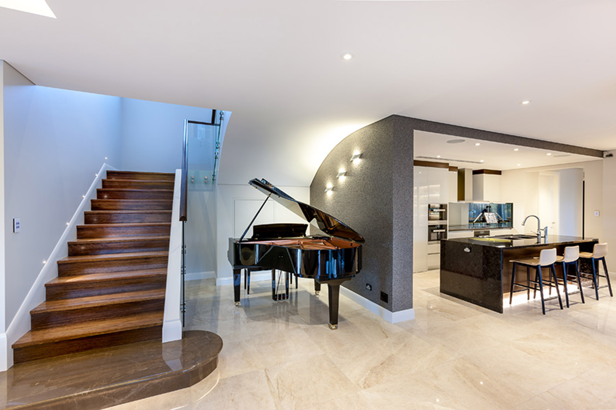 grand piano on porcelain stone floor with granite benchtops
