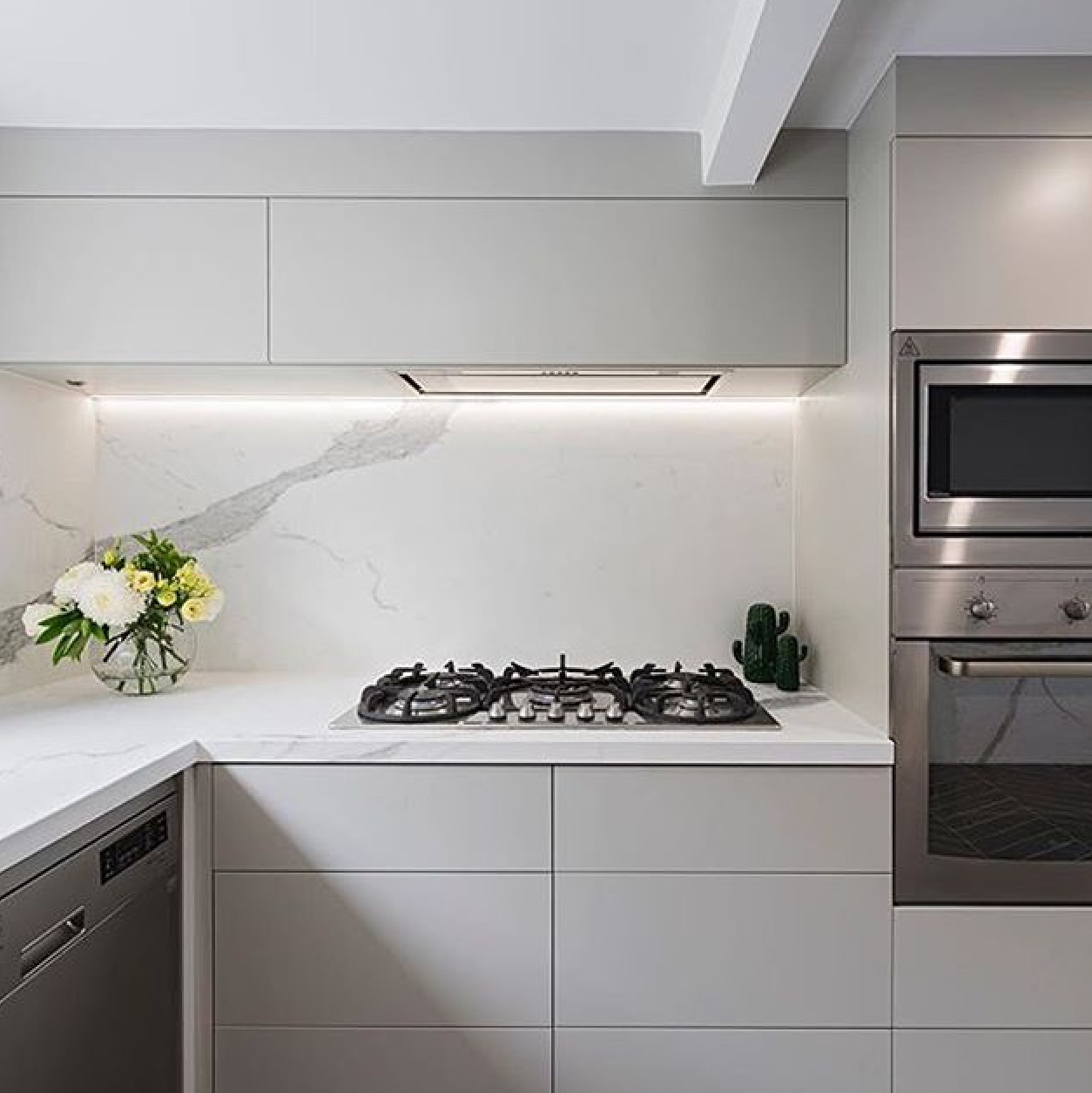 white marble benchtop and gas cooktop