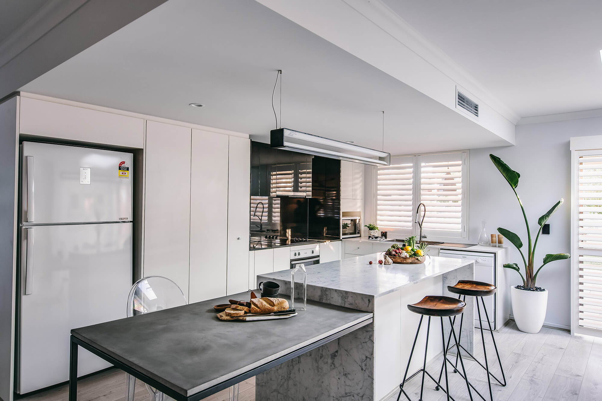 bravvo perth marble kitchen island and fridge