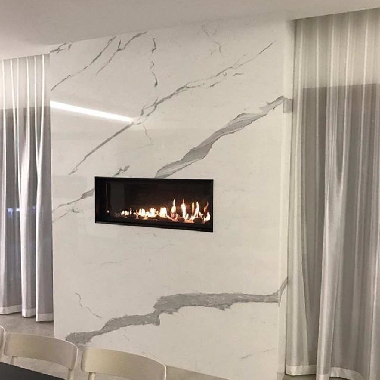 marble stone feature wall with fireplace