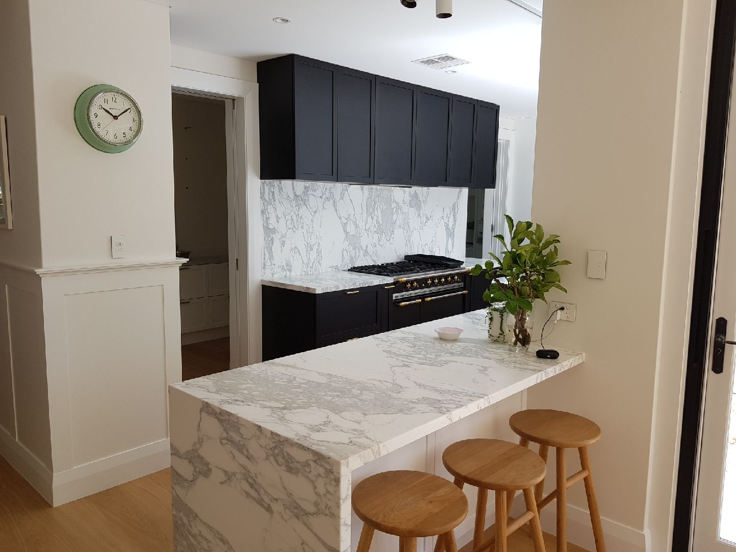 marble stone bench and cooktop splashback