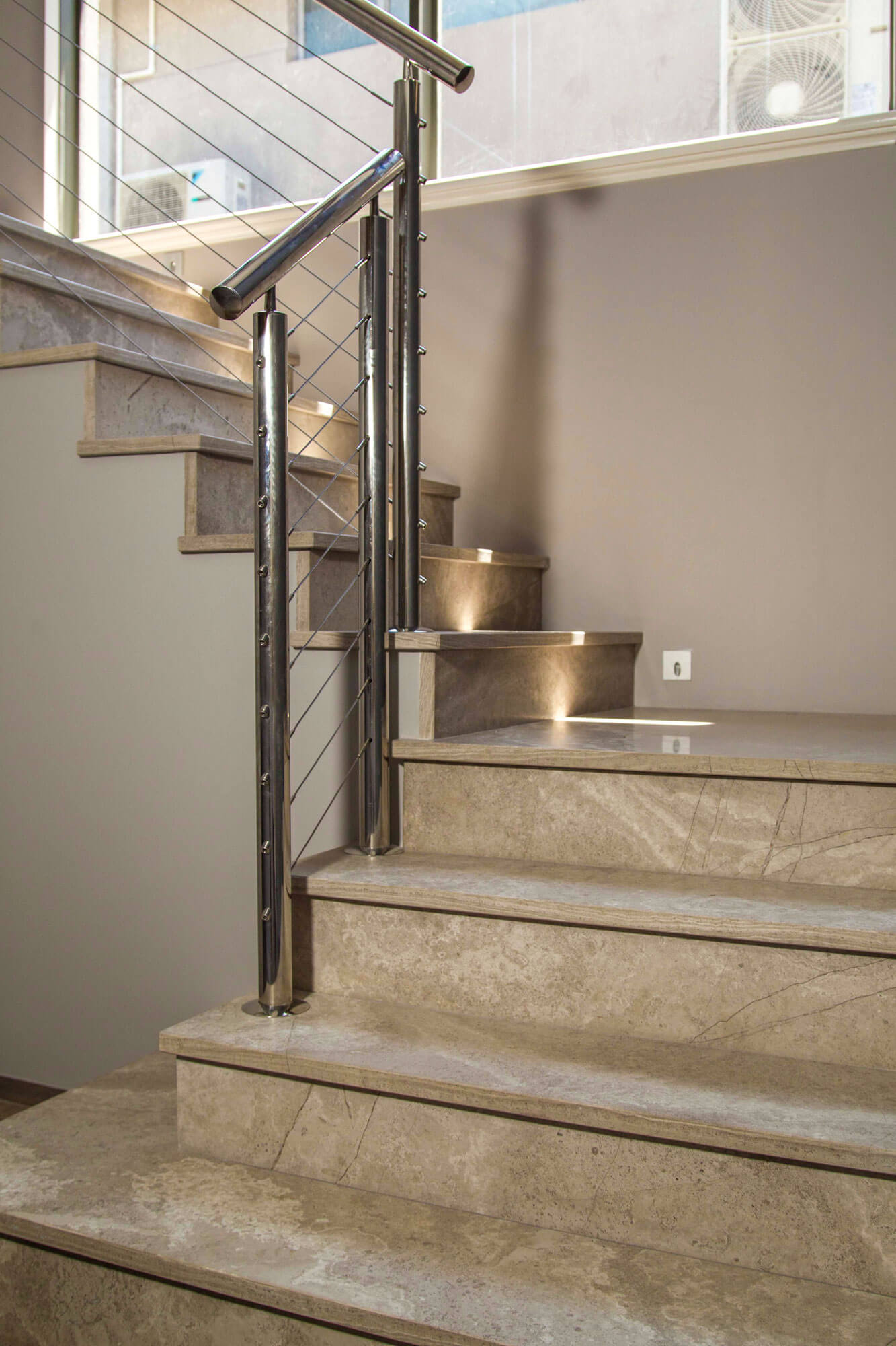 marble stone stairs metal railing
