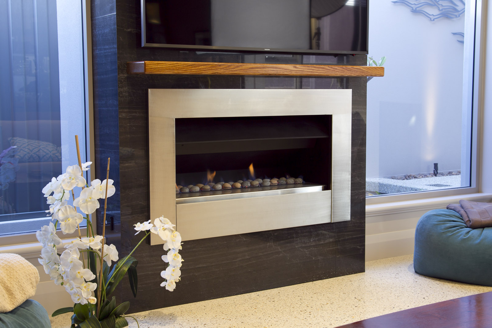 porcelain stone feature-wall surrounding stainless steel fireplace