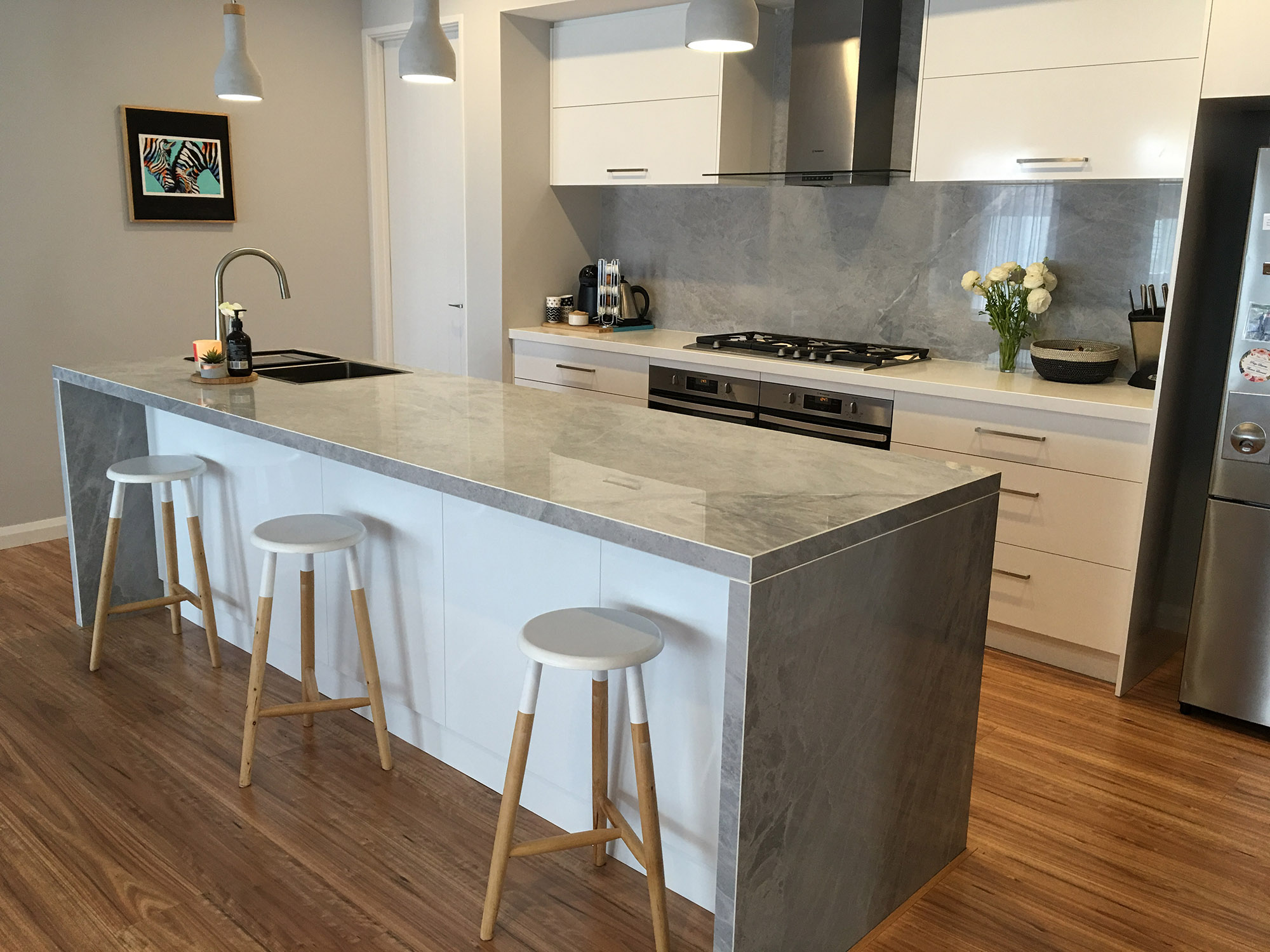 porcelain stone benchtop and chairs